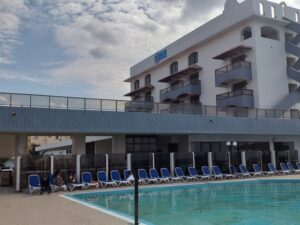 Swimming pool and deck chairs are on the territory of Hotel Copacabana